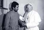 Иоанн Павел II беседует с Мехмет Али Агджой